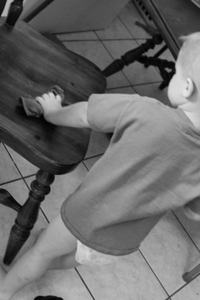 my son cleaning a chair