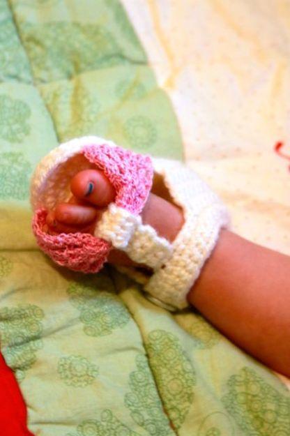 baby foot in crocheted shoe