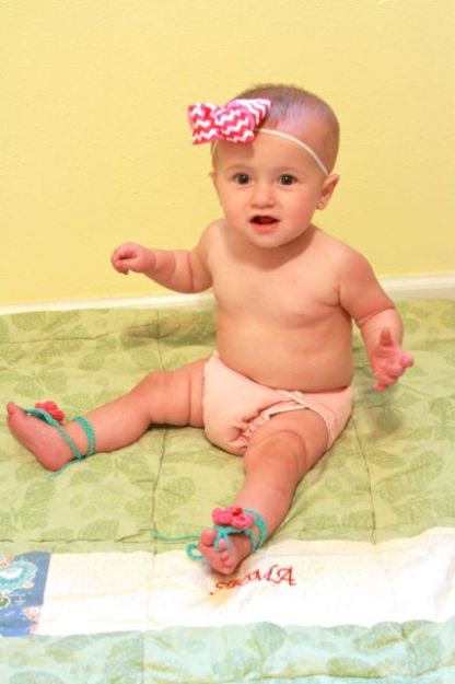 my daughter modeling a new hair bow and barefoot sandals