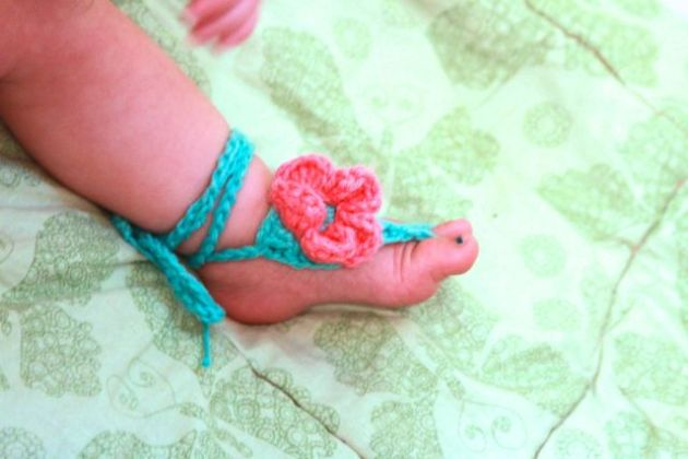 baby foot in barefoot sandal crocheted by Growing Grace
