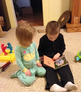 boy reading to his sister