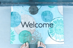 welcome mat and painted toes