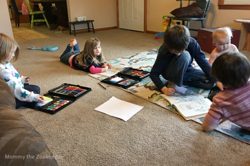 kids coloring together