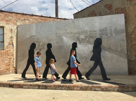 kids in front of beatles park monument